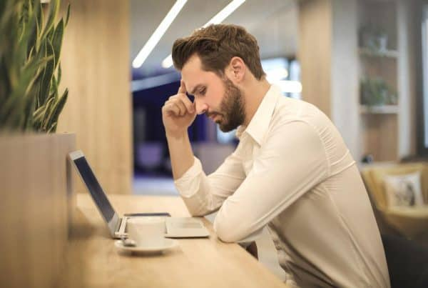 Man sitting at office workstation